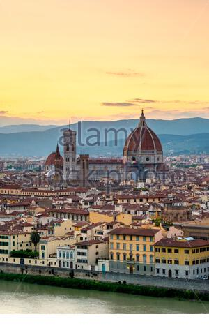 Florence Cathedral (Duomo di Firenze) and buildings in the old town at sunset, Florence (Firenze), Tuscany, Italy, Europe. - Stock Photo