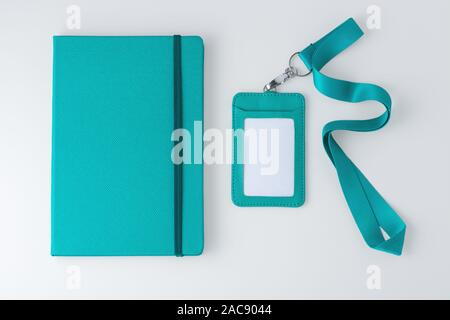 Leather notebook with badge and lanyard, pastel blue, corporate and event gift, mock up, top view - Stock Photo
