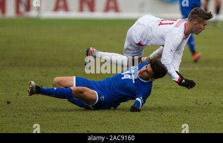 Indiana University's Joshua Penn (11) collides with University California Santa Barbara's Mate Restrepo Mejia (5) during an NCAA tournament sweet 16 soccer game at Armstrong Stadium, Sunday, December 1, 2019 in Bloomington, Indiana. IU lost to UCSB 1-0 in overtime. UCSB's Will Baynham scored the goal to upset the Hoosiers on OT. - Stock Photo