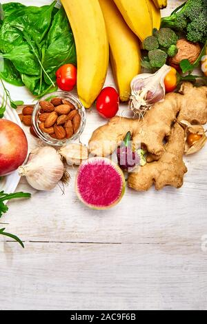 Selection of food rich in antioxidants and vitamins and mineral  sources, vegan food  on white wooden background. Healthy balanced dieting concept, in - Stock Photo