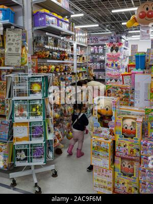mother and child in toy department, Bic Camera consumer electronics store, Ginza, Tokyo, Japan - Stock Photo