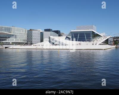 Wonderful view to european Oslo capital city reflected in water in Norway at Ostlandet district - Stock Photo