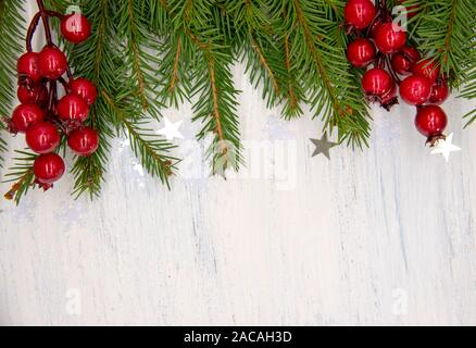 Christmas decor on a white wooden background. - Stock Photo