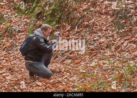 Photographer taken photo in autumn over a orange leaves carpet - Stock Photo