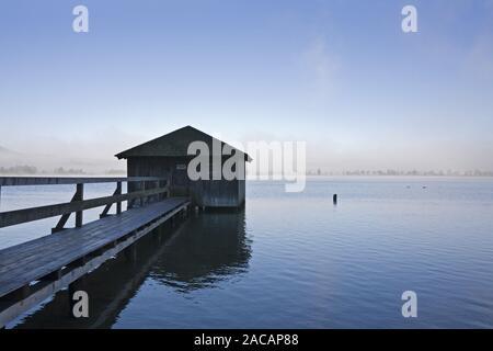 boatshouse at Kochelsee with fog, upper bavaria