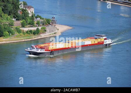 A container ship crosses the Rhine, Upper Middle Rhine Valley, Rhineland-Palatinate, Germany, Europe - Stock Photo