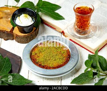 turkish dessert kunefe with ice cream - Stock Photo