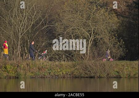 Aberystwyth ceredigion Wales/UK December 1 2019: Family walking around the lake at Bwlch Nant yr Arian visitors centre - Stock Photo