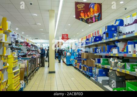 Customers shopping in an aisle in ALDI Supermarket in Newquay in Cornwall.