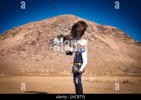 An eagle hunter in Kyrgyzstan, Central Asia - Stock Photo