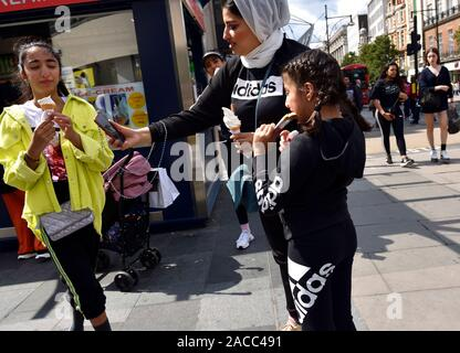 London, England, UK. Asian family eating ice cream and taking a selfie - Stock Photo