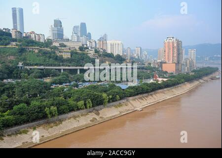 04.08.2012, Chongqing, China - Elevated view of the city on the shore of the Yangtze River. The megacity is situated at the confluence of two rivers. - Stock Photo