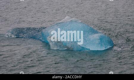 A small iceberg (bergy bit) in the Kongsfjorden on the island of Spitsbergen. - Stock Photo