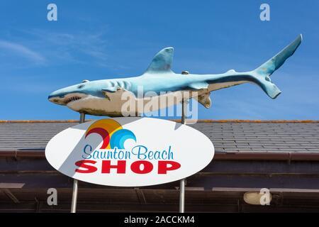 Beach shop entrance sign on Saunton Sands Beach promenade, Saunton, Devon, England, United Kingdom - Stock Photo
