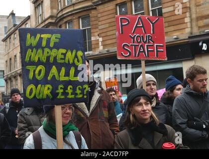 Glasgow, UK. 2nd Dec, 2019. UK. Members of the University and College Union (UCU) at 60 institutions are taking strike action from 25 November - 4 December. They are striking for better pay and working conditions. These workers gathered at the city's Buchanan Street steps with banners and flags Credit: Douglas Carr/Alamy Live News - Stock Photo