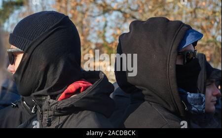 Braunschweig, Germany, November 30., 2019: Demonstrators dressed in black and hooded in the black block of the protest event - Stock Photo
