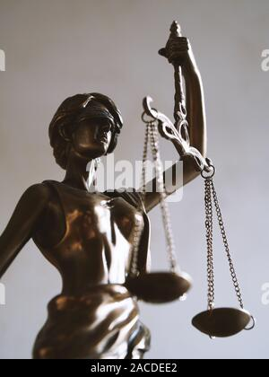 lady justice or justitia - blindfolded figurine holding balance scales - law jurisdiction and impartiality symbol - Stock Photo