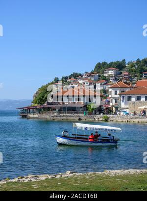 Looking across the harbour to the Old city of Ohrid on the shore of Lake Ohrid  in North Macedonia,   Europe. - Stock Photo