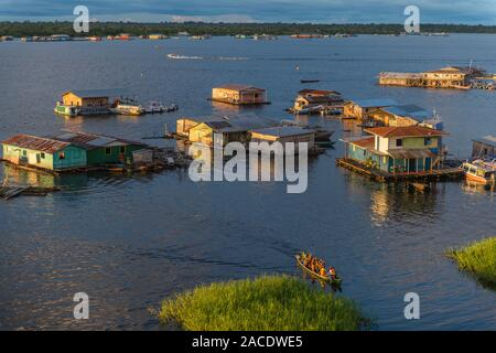 Swimming houses on Lake Tefé, small town of Tefé on SolimoesRiver, Amazon State, Northern Brasilia, Latin America - Stock Photo