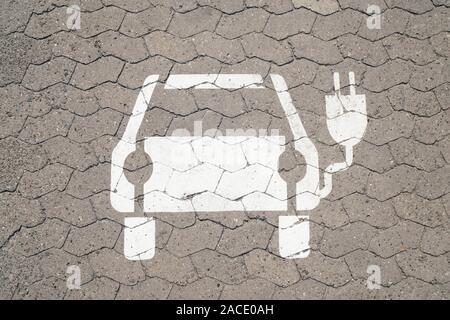 electric car charging station pictogram symbol painted on parking space - e-mobility concept - Stock Photo