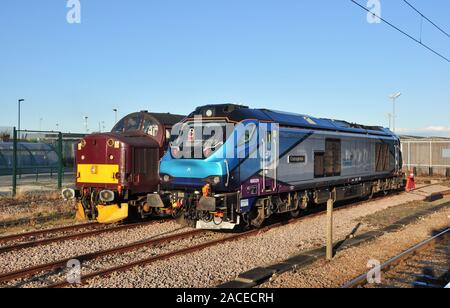 Classes 37 and 68 diesel locomotives, 37706 and 68029 'Courageous' at York station, North Yorkshire, England, UK - Stock Photo