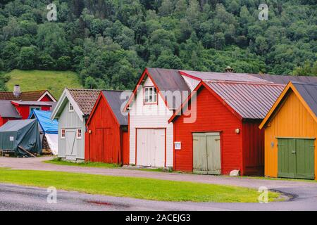 Countryside view of colored wooden buildings. Boathouses in Norway. Scandinavian traditional boat houses. multi-colored garage wooden houses in - Stock Photo