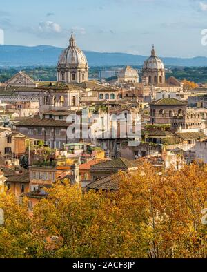 Rome skyline during autumn season as seen from Castel Sant'Angelo, with the domes of the churches of Sant'Andrea della Valle and San Carlo ai Catinari