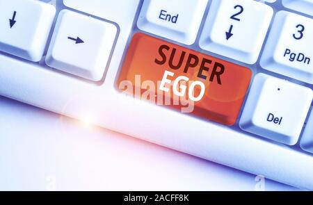 Writing note showing Super Ego. Business concept for The I or self of any demonstrating that is empowering his whole soul White pc keyboard with note - Stock Photo