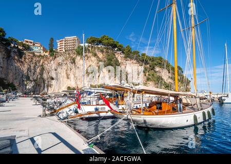 Monte Carlo, Monaco - September 26 2019: Sailboats and yachts moored in the Fontvieille Port along the Riviera in Monaco. - Stock Photo