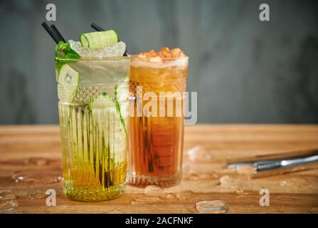 Two glasses with refreshing drinks. Delicious refreshing waters with cucumber and cinnamon in glasses - Stock Photo