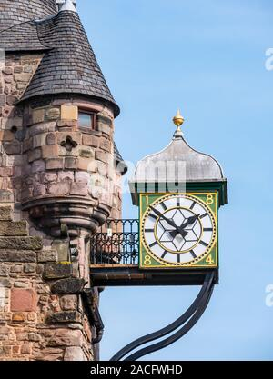 Old Canongate Tolbooth, Royal Mile, Edinburgh, Scotland, now Scottish Storytelling Centre bell tower clock with blue sky - Stock Photo