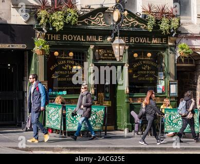 The Royal pub with pavement tables and people walking past  in sunshine,  Edinburgh, Scotland, UK - Stock Photo