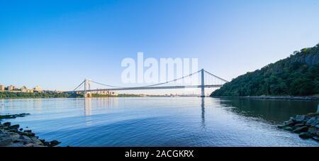 George Washington Bridge panorama above the New York skyline - Stock Photo