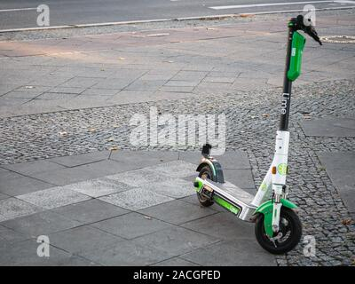 BERLIN, GERMANY - OCTOBER 10, 2019: Motorized Electric Scooter By Lime In Berlin, Germany - Stock Photo