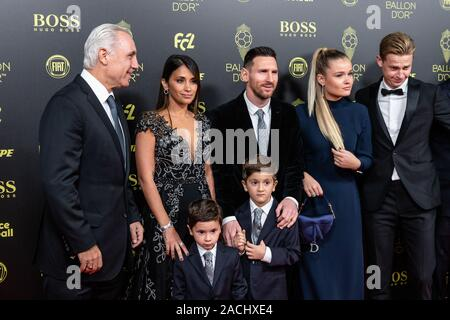 Paris, France. 2nd Dec, 2019. Former Barcelona forward Hristo Stoichkov (1st L), Barcelona's Argentinian forward Lionel Messi (3rd L) and his wife Antonella Roccuzzo (2nd L) arrive to attend the Ballon d'Or 2019 awards ceremony at the Theatre du Chatelet in Paris, France, Dec. 2, 2019. Credit: Aurelien Morissard/Xinhua/Alamy Live News - Stock Photo