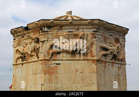 Carvings on the Tower of the Winds in Athens, Greece - Stock Photo