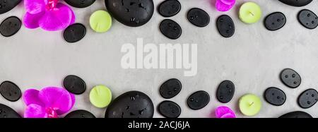 Top view of hot spa stones set for massage treatment and bamboo on concrete background with copy space. Elegant and luxury spa. Flat lay, overhead, mo - Stock Photo