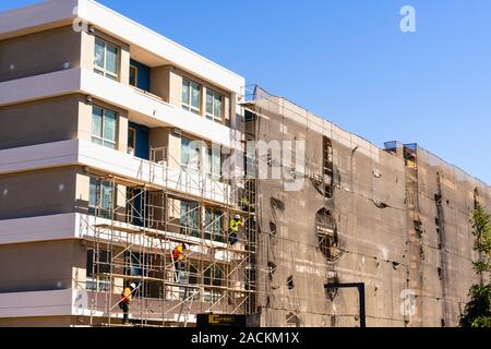 Aug 15, 2019 San Mateo / CA / USA - Multifamily residential building under construction; Silicon Valley and the San Francisco Bay Area is currently fa - Stock Photo