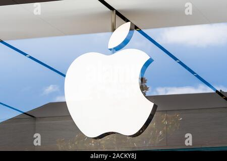 Aug 20, 2019 Palo Alto / CA / USA - Apple logo above the entrance to the store located in Stanford shopping center - Stock Photo