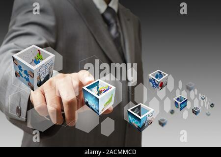 Businessman hand touch virtual button and 3d images - Stock Photo