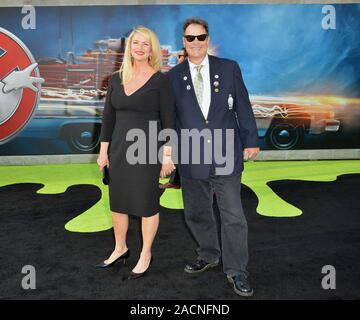 LOS ANGELES, CA. July 9, 2016: Actor Dan Aykroyd & wife Donna Dixon at the Los Angeles premiere of 'Ghostbusters' at the TCL Chinese Theatre, Hollywood. © 2016 Paul Smith / Featureflash - Stock Photo