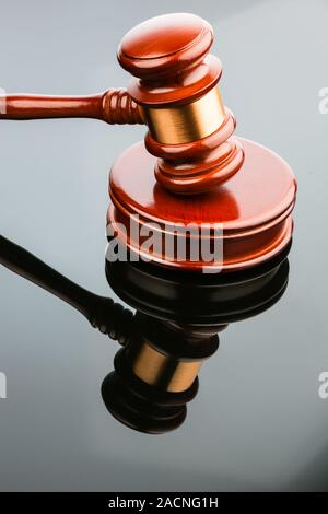 Auction hammer reflects itself - Stock Photo