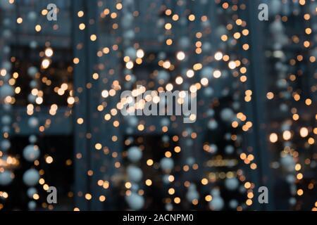 Big City Lights. Blurred garland. Night Light, bokeh, defocused background. Christmas holiday abstract. - Stock Photo