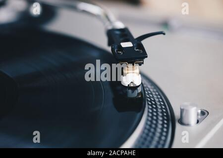 Hip hop dj turntable records player.Vintage analog turn table playing vinyl disc with music.Professional audio equipment for disc jockey. - Stock Photo