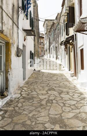 Picturesque alley in a greek mountain village on Corfu - Stock Photo