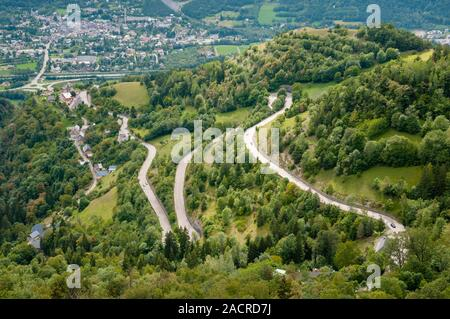 Le Bourg-d'Oisans and the D211 winding road, popular with cyclists and on the Tour de France, leading up to the Alpe d'Huez, Isere (38), France - Stock Photo