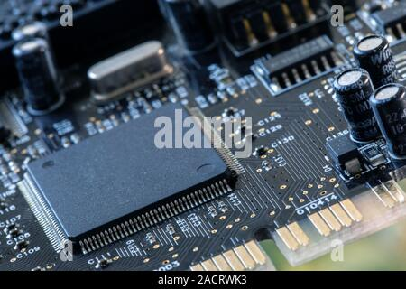 Integrated semiconductor microprocessor on a circuit board. Photo of electric component in electronic device - Stock Photo