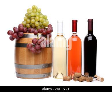 Grape, barrel, corks, corkscrew, bottles of wine - Stock Photo