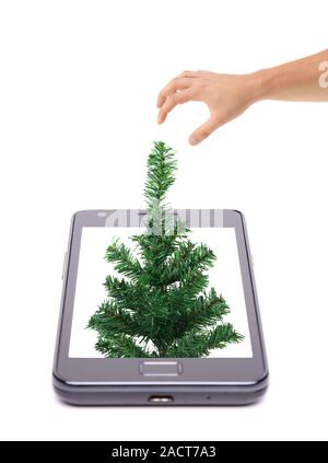 Christmas tree grows from phone. - Stock Photo