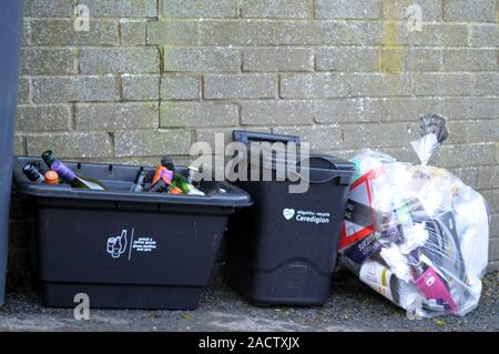 Aberystwyth Ceredigion/UK December 3 2019:  Kerbside glass, waste food and mixed recycling containers used in Ceredigion, Wales, UK - Stock Photo